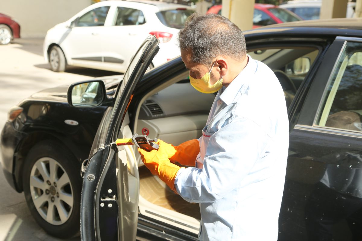 Car door rubber seal being treated